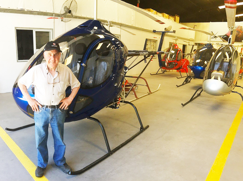 Augusto Cicare with his many helicopters
