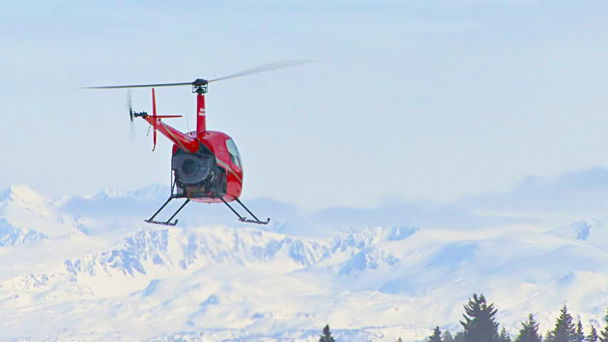 Flying helicopter in mountain weather