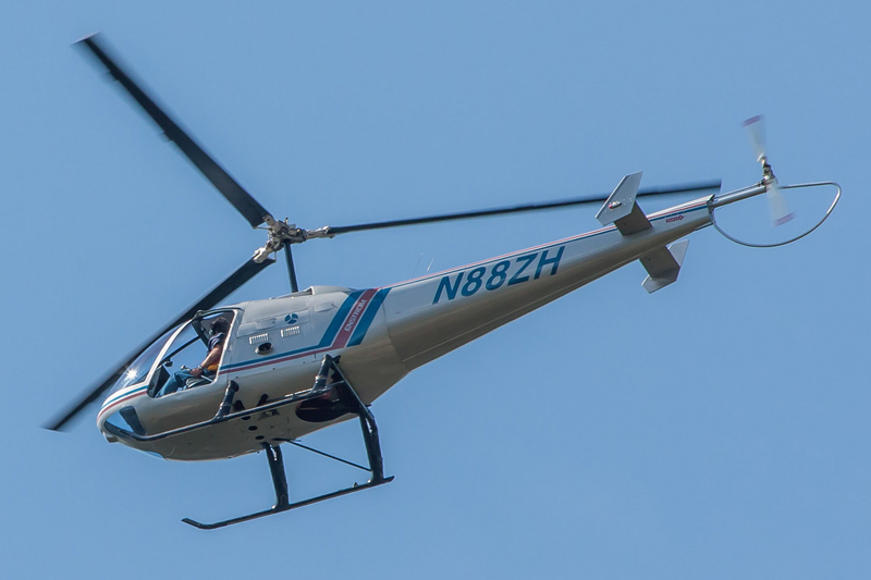 Enstrom helicopter flying high