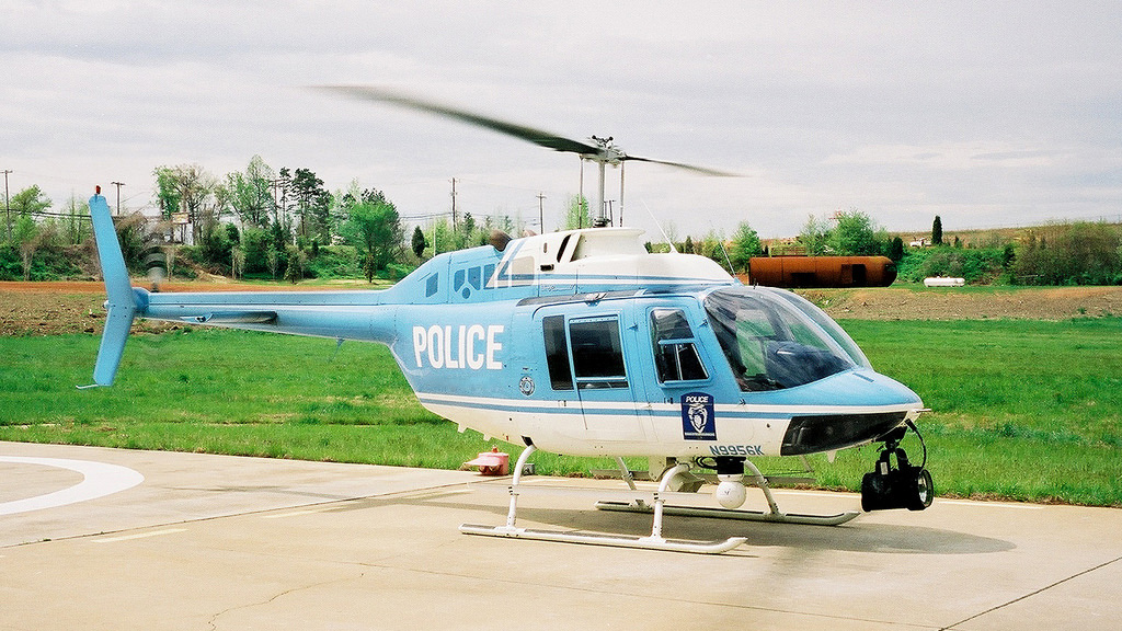Police helicopter night sun